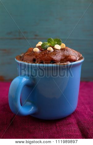chocolate cake in a blue cup