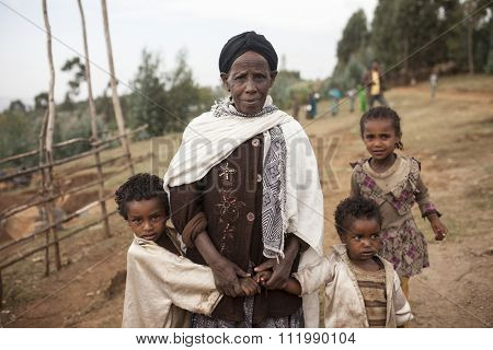 OROMIA, ETHIOPIA-APRIL 22, 2015: Unidentified grandmother and her grandchildren in a poor region of Oromia, Ethiopia.
