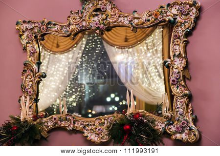Mirror in an ancient wooden frame