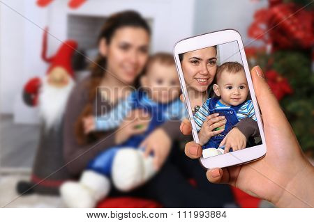 Taking Picture Of Mother And Boy Child