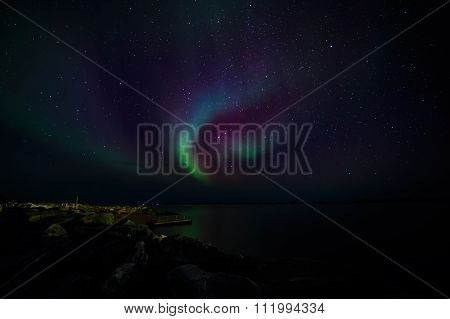Northern Lights On A Shore