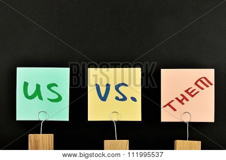 Us Vs Them Three Paper Notes Isolated On Black