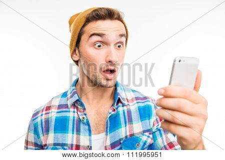 A Portrait Of Surprised Young Man With Mobile Phone