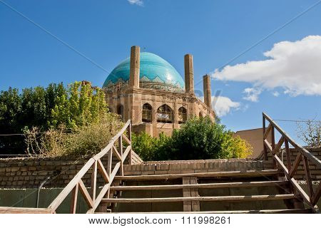 Wooden Stairs To The 14 Century Blue Domed And Brick Walled Mausoleum, Iran. Unesco World Heritage S