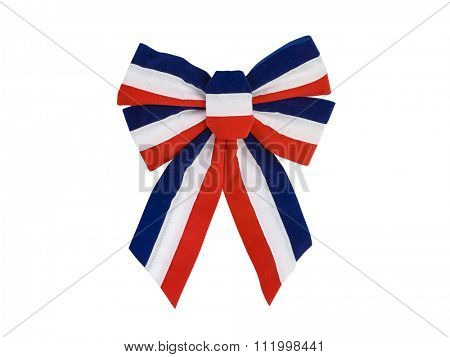 Patriotic red, white and blue holiday bow isolated on white