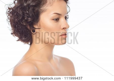Young attractive woman looks aside.