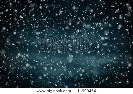 Dense snow flurries before evening sky