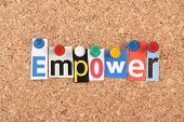 stock photo of empower  - The word Empower in cut out magazine letters pinned to a cork notice board - JPG