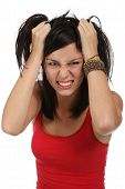 stock photo of beautiful brunette woman  - Pretty young lady with frustrated look and hands in her hair - JPG