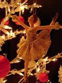 picture of ballet dancer  - ballerina christmas ornament hung from lighted twig tree - JPG