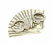 image of snitch  - Handcuffs on money background - JPG
