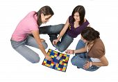 foto of boardgame  - friends playing board games over a white background - JPG