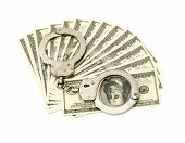 stock photo of snitch  - Handcuffs on money background - JPG