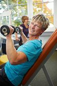 Senior Woman Doing Weight Training