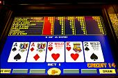 stock photo of poker machine  - 4 of a kind hand on poker game - JPG