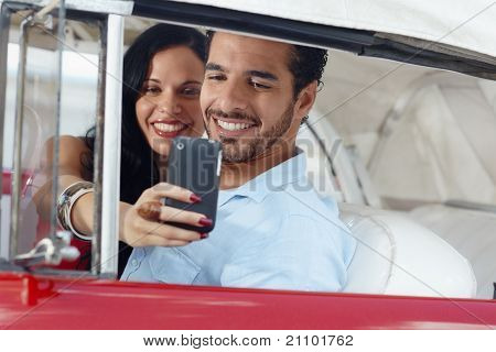 People Taking Souvenir Picture With Mobile Telephone