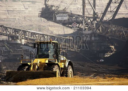 Bucket-wheel Excavator And A Shovel Digging In A Coal-mine