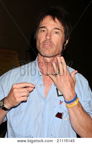 LAS VEGAS - JUN 18:  Ronn Moss showing his new ring, and wedding ring on a chain at the Daytime Emmy Gifting Suite at Hilton Hotel on June 18, 2010 in Las Vegas, NV.