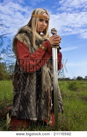 Viking Girl On A Blue Sky Background