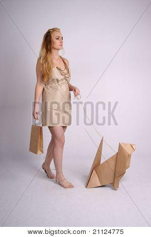 Woman walking eco dog holding eco-friendly bag
