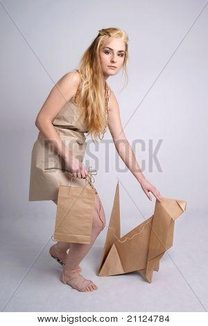 Woman wearing eco clothes stroking eco dog