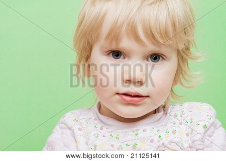 Bright Picture Baby Girl On The Light Green Background.