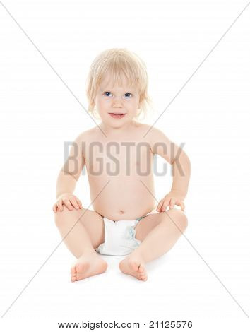 Cute Baby Sits Smiling Isolated On White