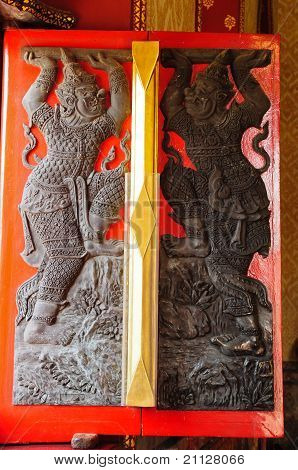 Traditional Thai Style Carving On Window Of Wat Benjamobopith