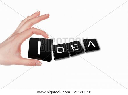 human hand making a business word puzzle