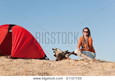 Camping Happy Woman Sitting By Campfire On Beach