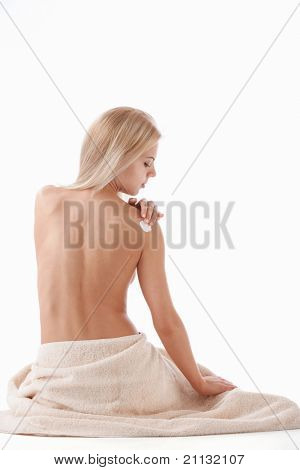 Nude attractive girl on a white background