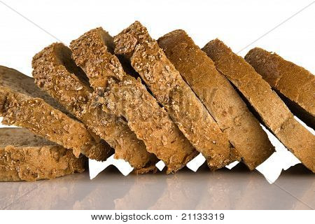 Sliced Brown Bread Isolated On A White Background