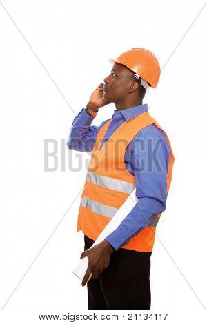 An african american foreman talking on the phone, isolated on white, side-view