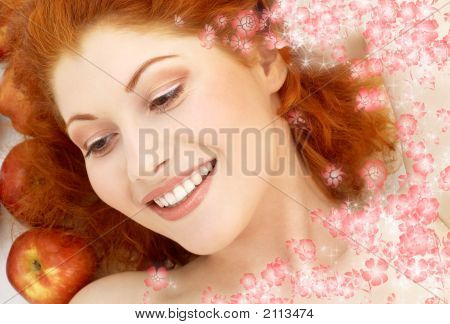 Lovely Redhead With Red Apples And Flowers