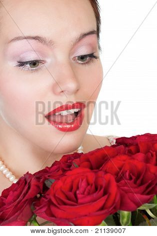 Lovely Woman With A Bouquet Of Red Roses