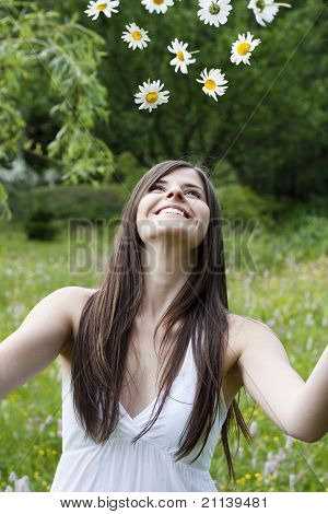 Girl Throws Flowers Into The Air