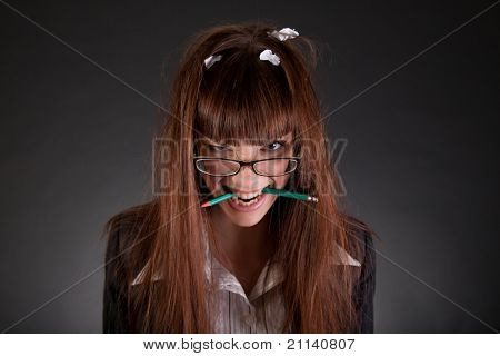 Angry businesswoman with broken pencil, studio shot