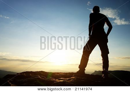 Silhouette of man in mountain. Conceptual scene.