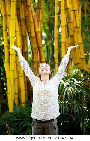 Enjoying the nature. Beauty woman arms raised enjoying the fresh air
