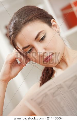 Woman Reading Business Newspaper