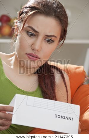 Shocked Woman With Bill Letter
