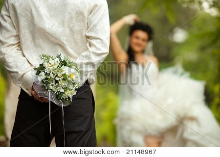 Colorful wedding shot of bride and groom with bouquet