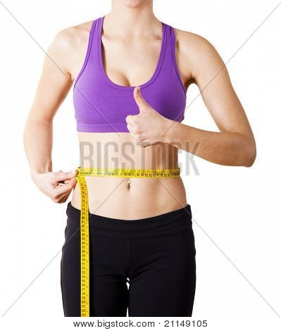 Athletic young women taking measurements of her own body - Healthy body concept