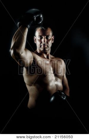 An image of a muscular male in a heroic pose