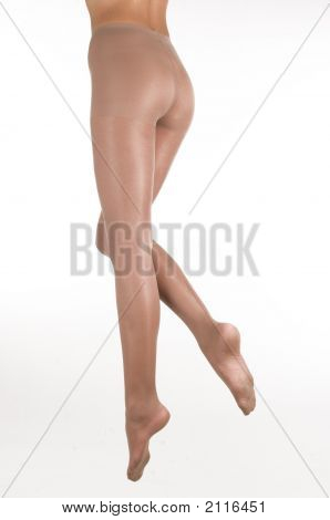 Female Legs In Stockings.