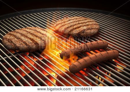 Hamburger patties and hot dogs on the grill under flaming coals