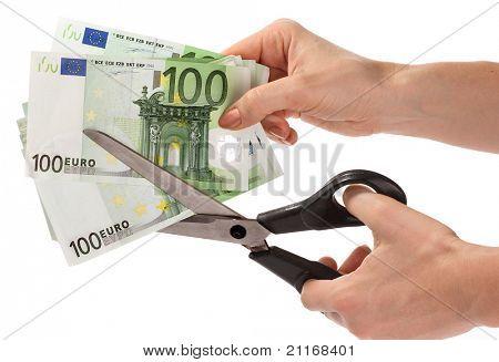 Tijeras y euros.