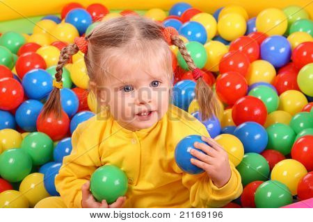 Birthday of smiling girl. Group of color ball backgrounds.