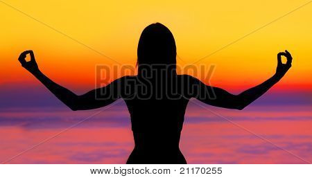 Yoga Woman Over Sunset