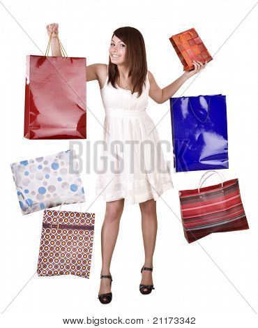 Young girl with falling shopping bag. Isolated.